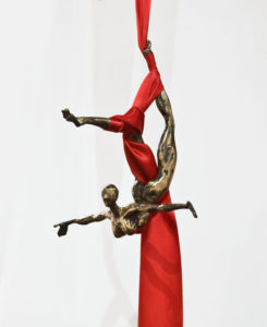 """Ribbon Dance I,"" by Tobias Luttmer figure dimensions 7 1/2"" (H) x 11"" (L) x 11 1/2"" (W) - bronze with ribbon $1500"