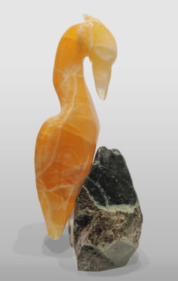 """Translucent Orange Heron,"" by Herb Latreille 21"" (H) - Calcite on Coquihalla jade base $4800"